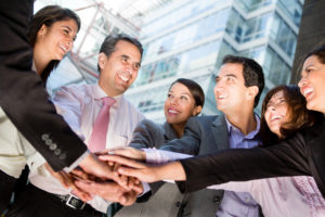 Business teamwork with a group of people with hands together